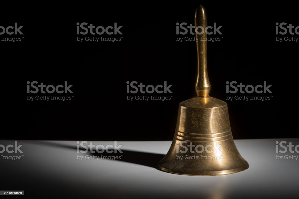 Closeup of a small metallic hand bell stock photo
