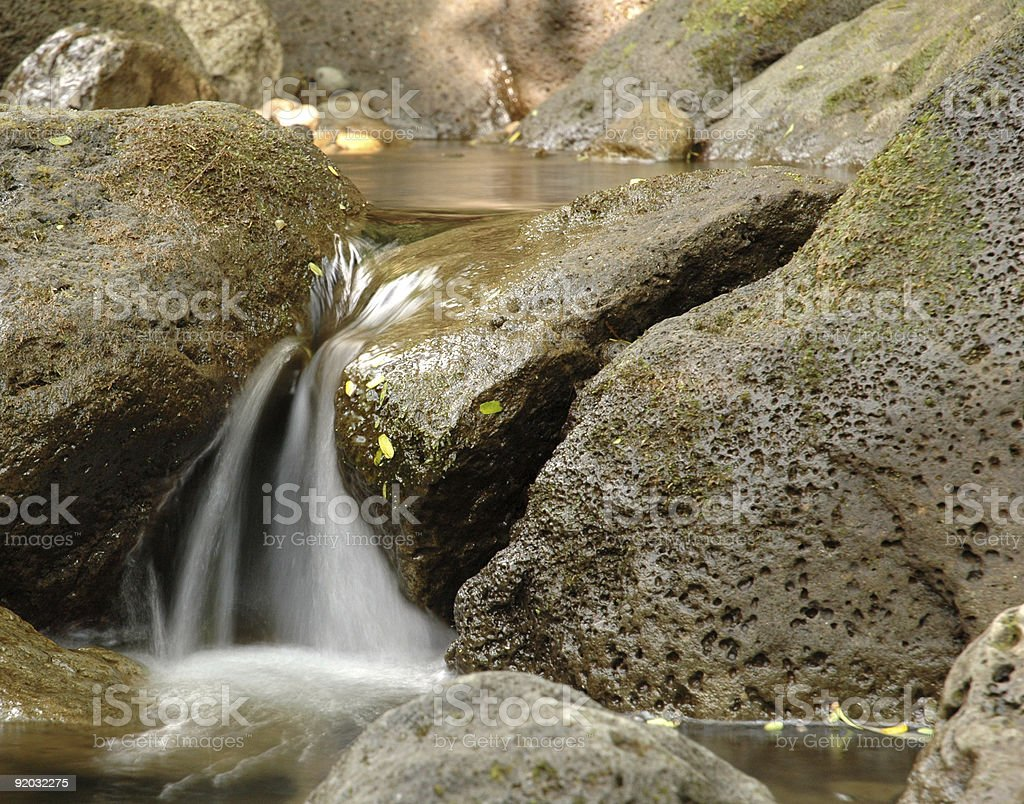 Close-up of a small waterfall in a forest stream stock photo