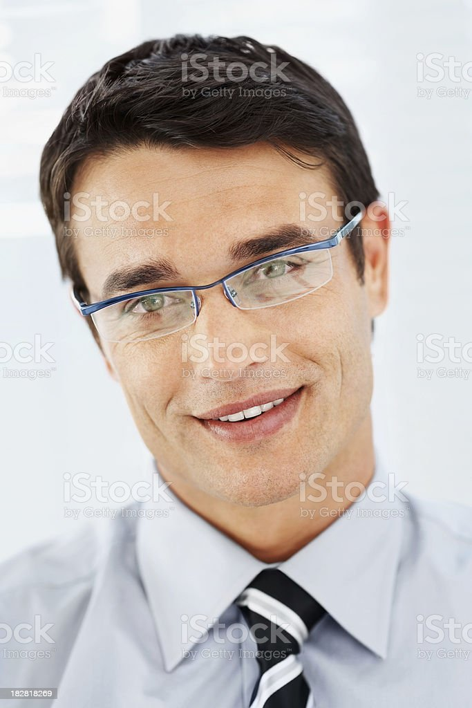 Close-up of a smiling business man wearing spectacles royalty-free stock photo