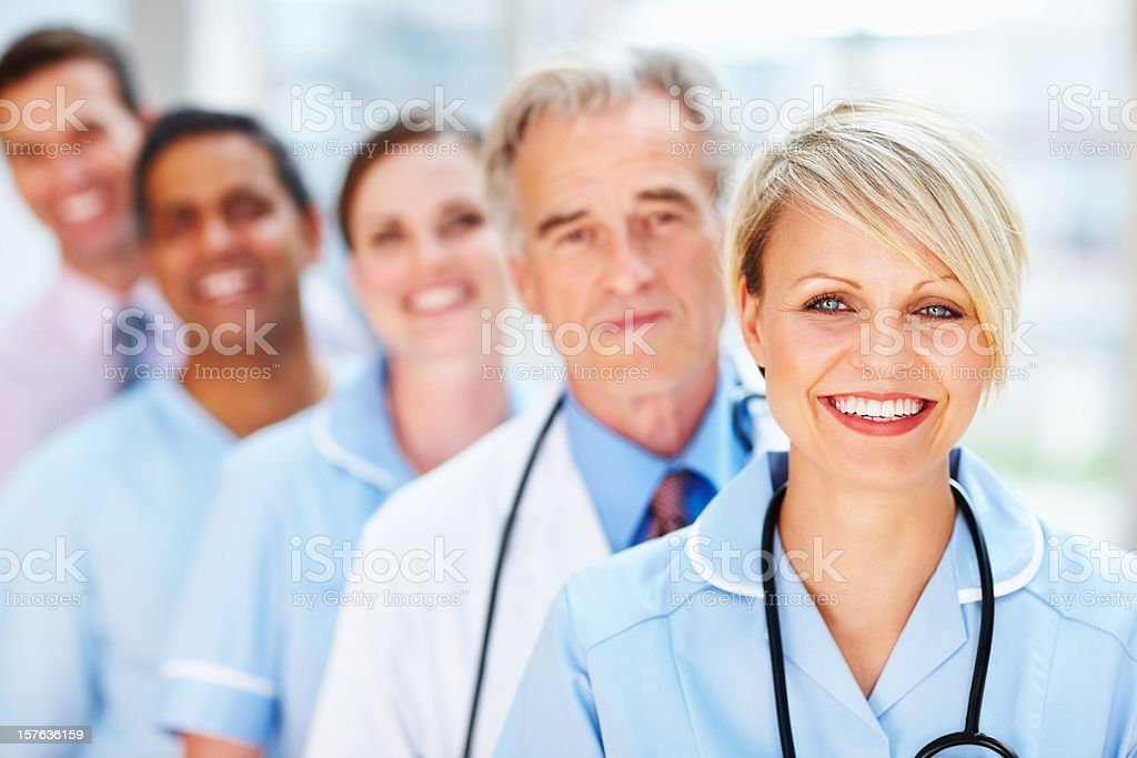 Close-up of a smiling doctor with her team royalty-free stock photo