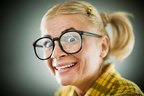 close-up of a smiling nerd wearing glasses. - stupidblonde stock pictures, royalty-free photos & images