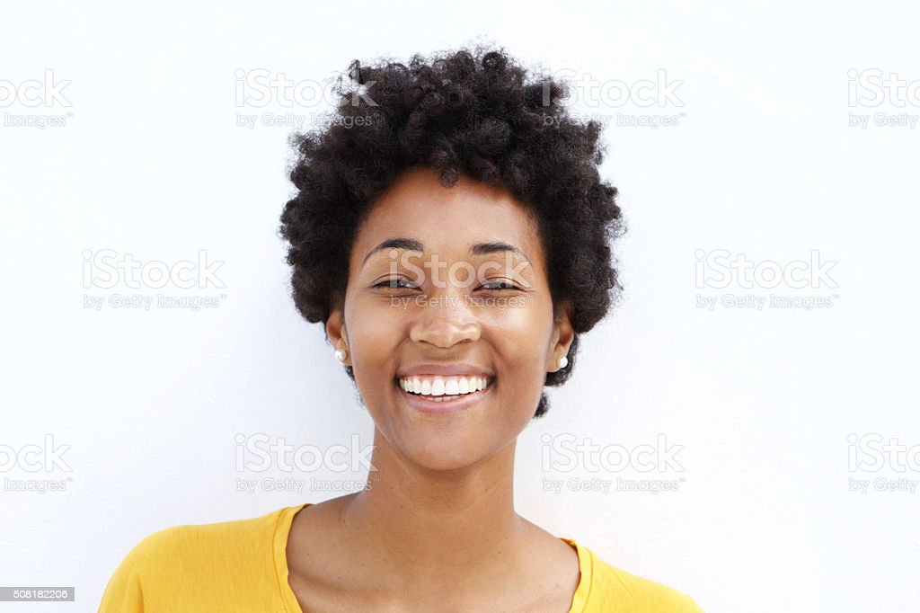 Closeup of a smiling young black woman​​​ foto