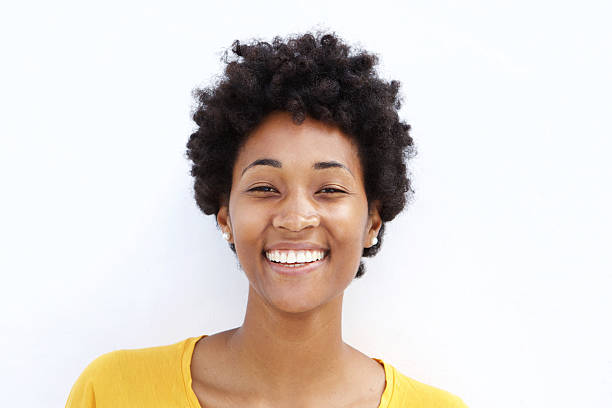 Closeup of a smiling young black woman stock photo