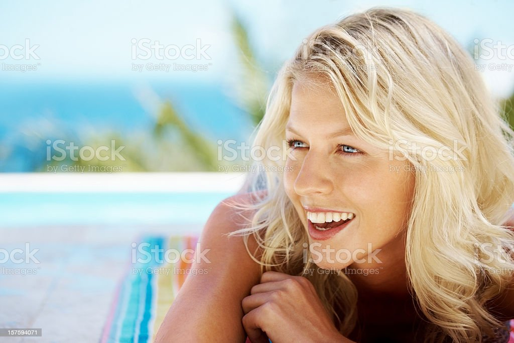 Close-up of a smiling young woman looking at copyspace royalty-free stock photo