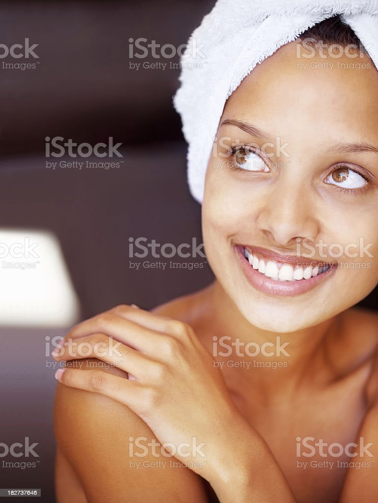 Close-up of a smiling young woman wrapped in towel royalty-free stock photo