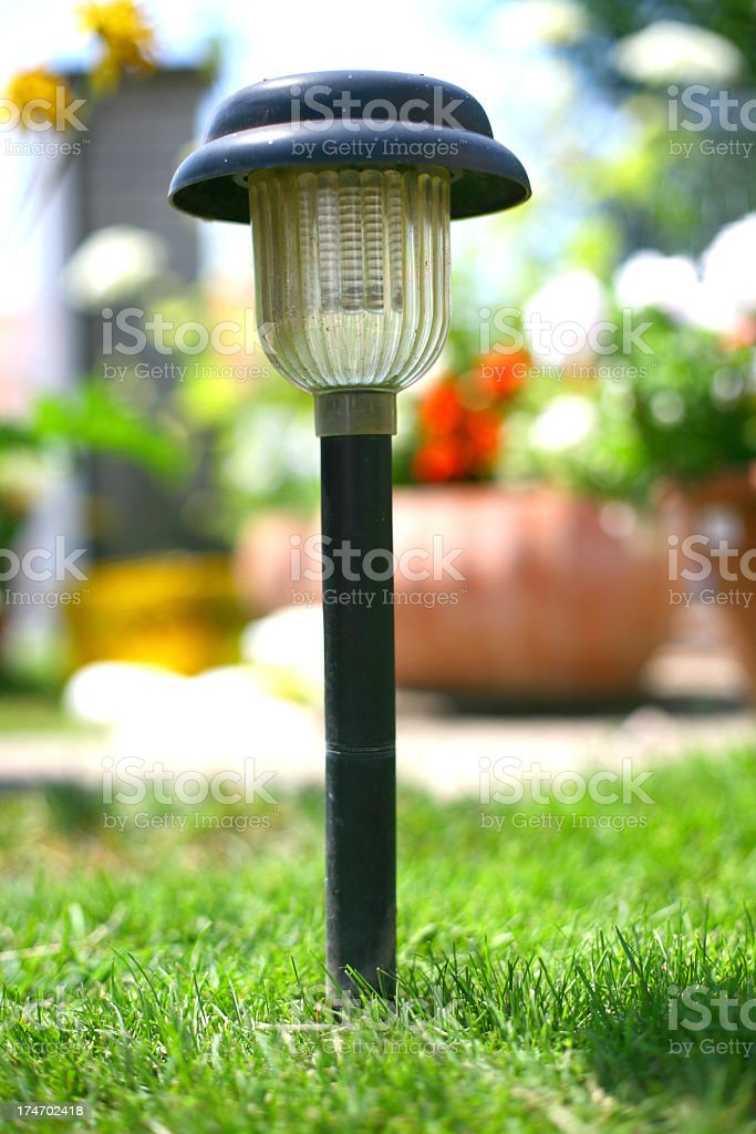 Close-up of a solar lamp in green grass stock photo