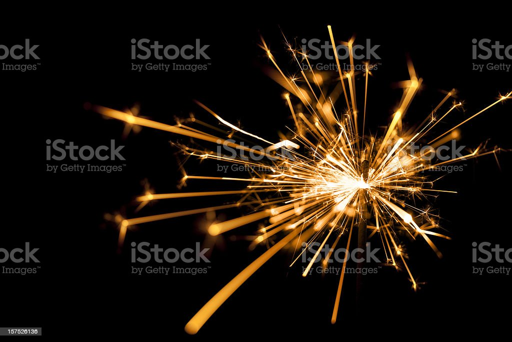 Close-up of a sparkler on black background stock photo