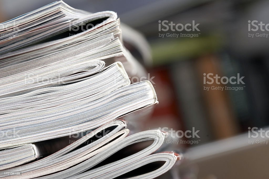 A closeup of a stack of magazines on a table stock photo