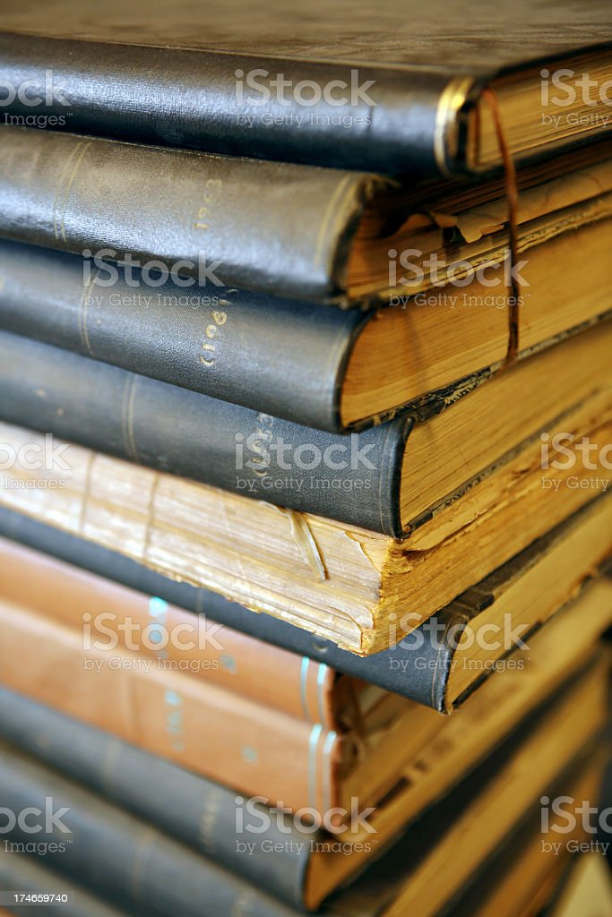 Closeup of a stack of old books stock photo