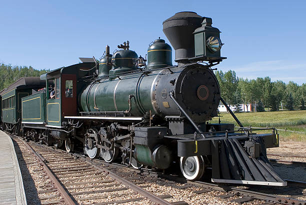 Close-up of a steam-powered train on its tracks stock photo