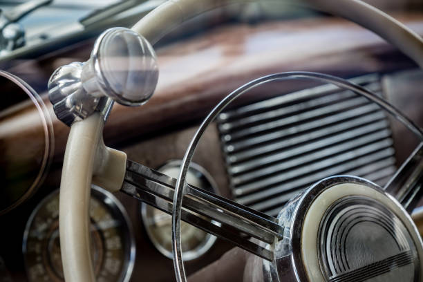 Close-up of a steering wheel in vintage car stock photo