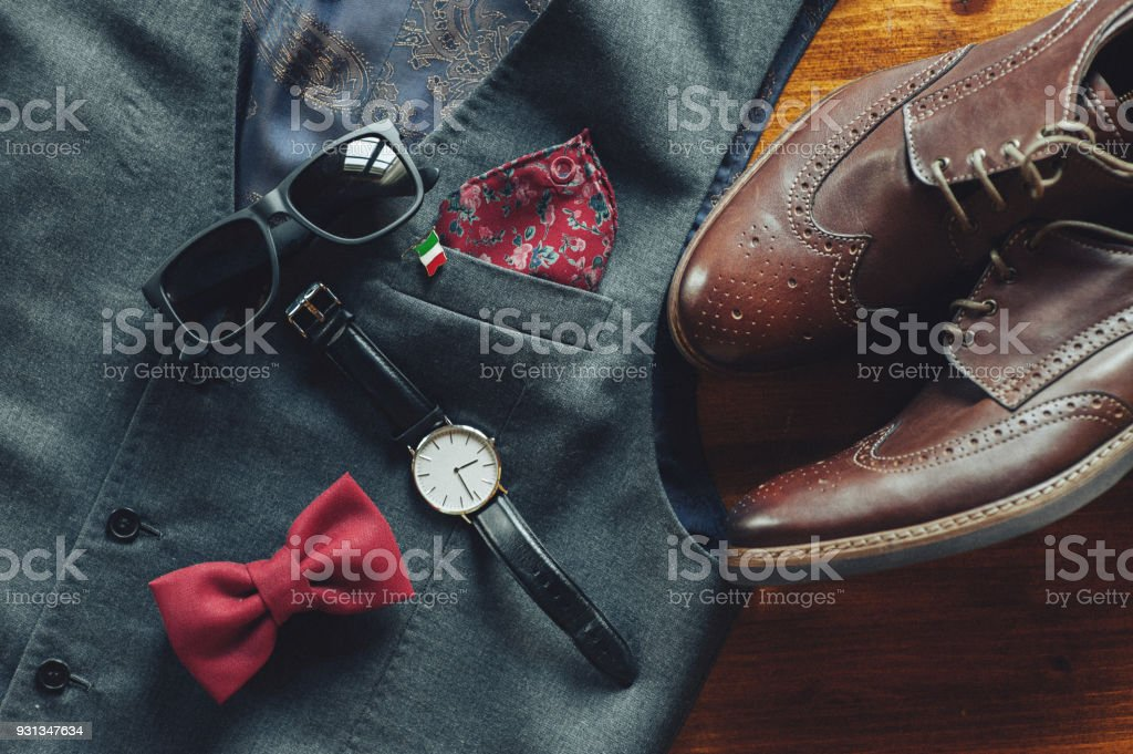 Close-up of a stylish bow tie and golden wedding rings stock photo