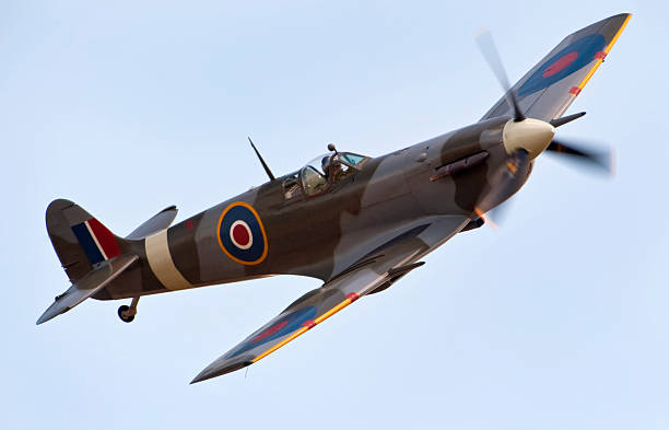 a close-up of a supermarine spitfire aircraft in flight - world war ii stock photos and pictures