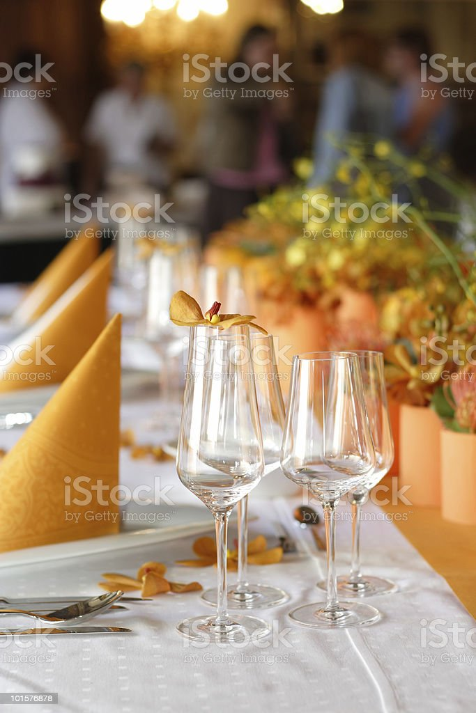 Close-up of a table set for a wedding with orange color royalty-free stock photo