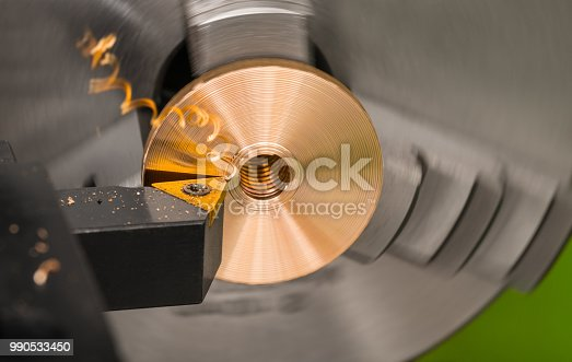 istock Close-up of a tool bit when turning on a lathe 990533450