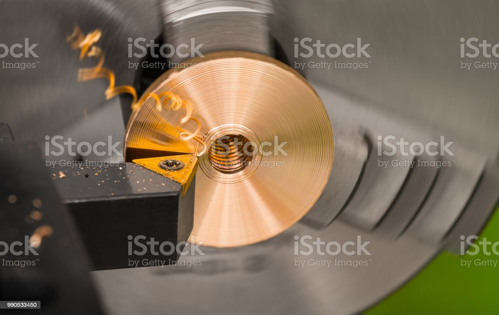 Close-up of a tool bit when turning on a lathe stock photo