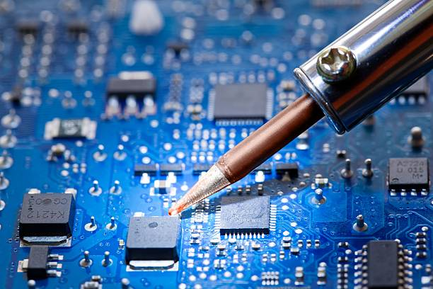 Close-up of a tool repairing an electronic component Troubleshooting and repair of a computer assembly payment soldering iron stock pictures, royalty-free photos & images