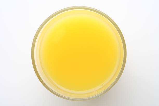 Closeup of a top-angle glass of orange juice stock photo