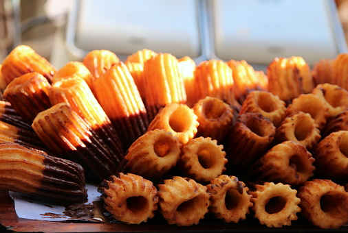 Close-up of a tray of churros in the sun