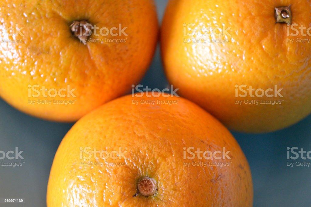 Closeup of a triad of oranges stock photo