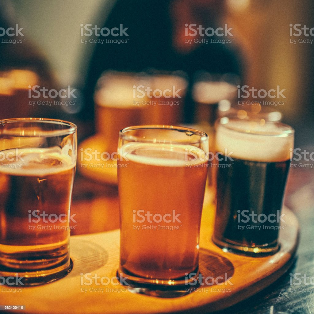 Close-up of a variety of beers, set on a beer flight. royalty-free stock photo