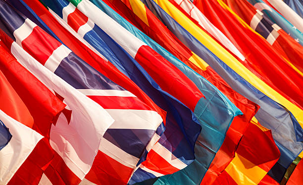 Closeup of a variety of national flags Several flags side by side. national flag stock pictures, royalty-free photos & images