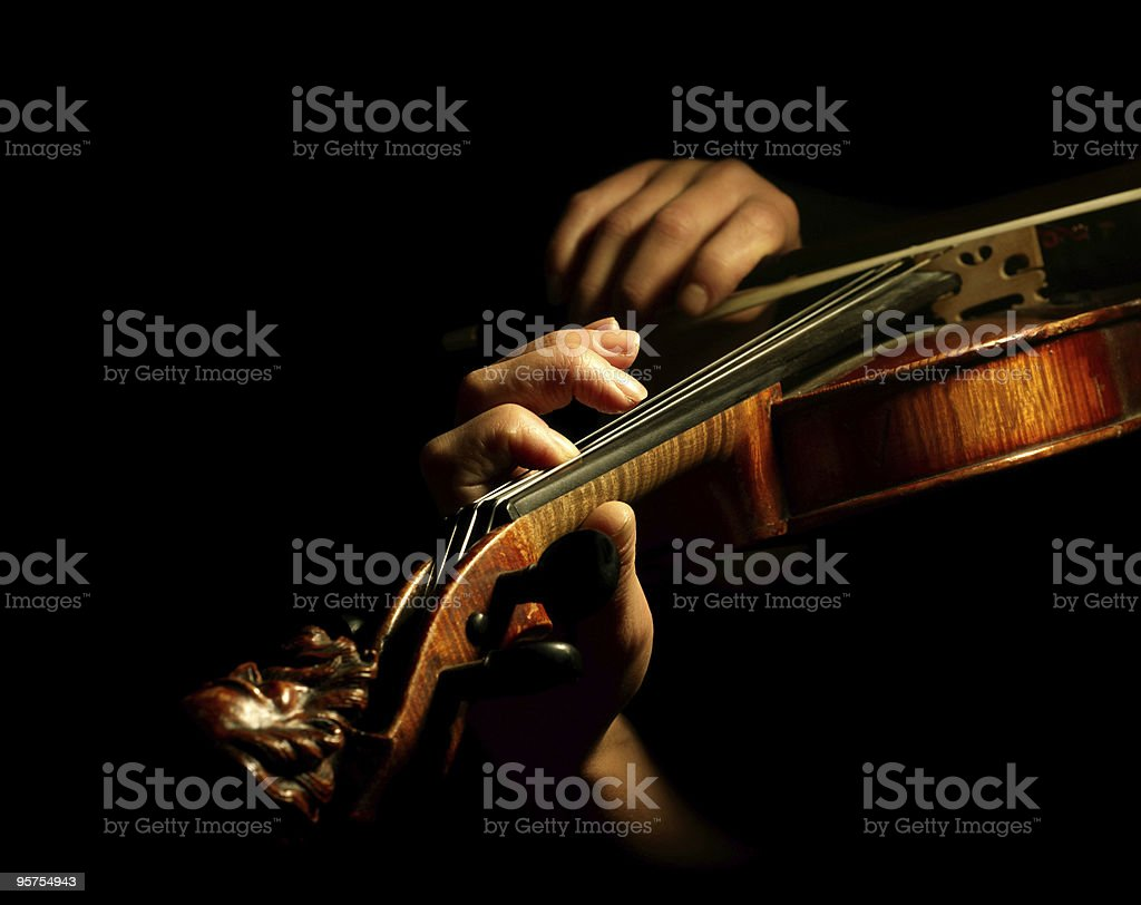 Close-up of a violin being played stock photo