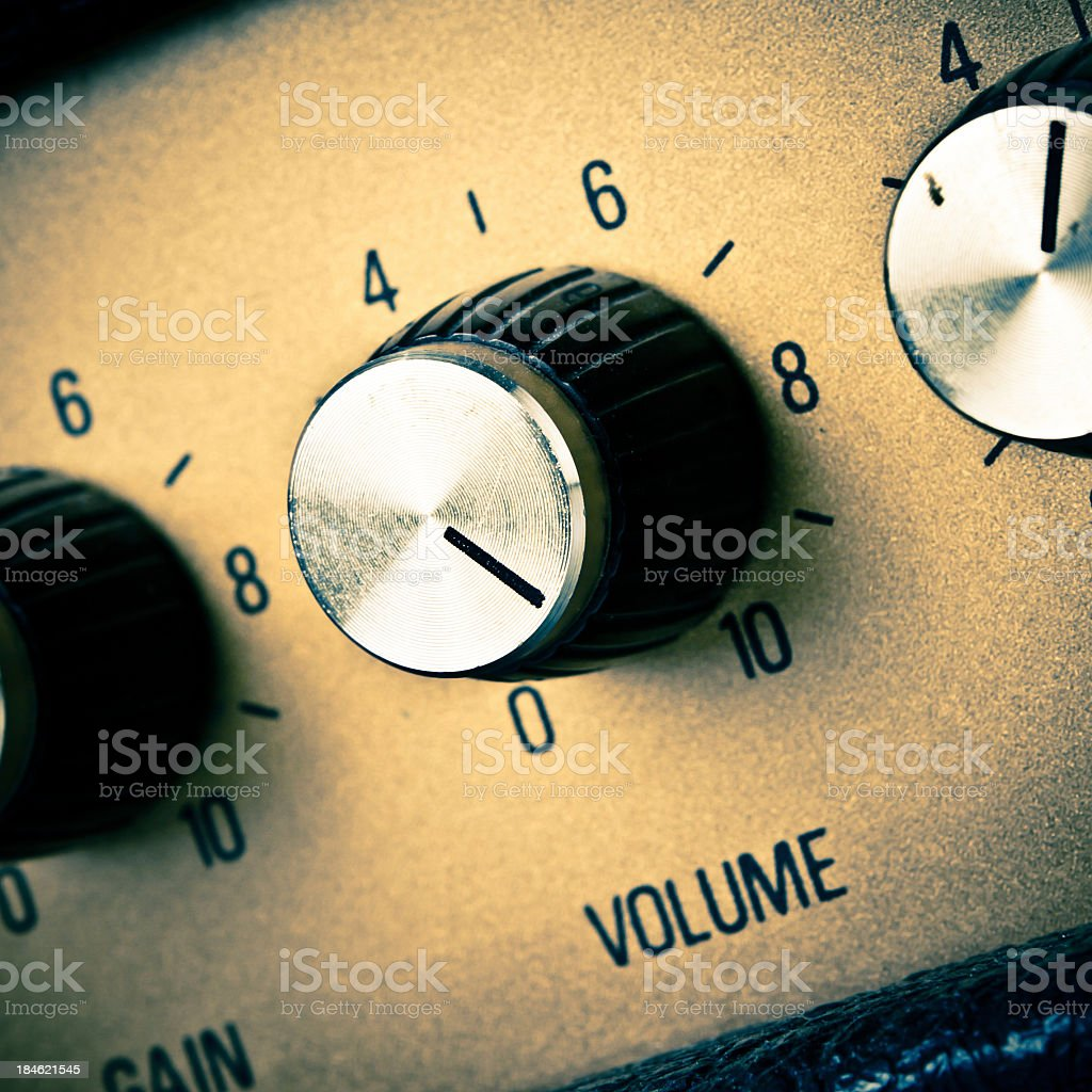 A close-up of a volume knob turned to ten stock photo
