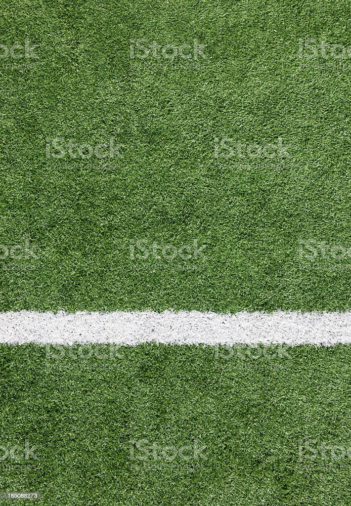 A close-up of a white line on a soccer field stock photo