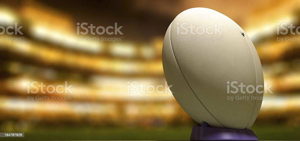 A close-up of a white rugby ball in the middle of a stadium stock photo