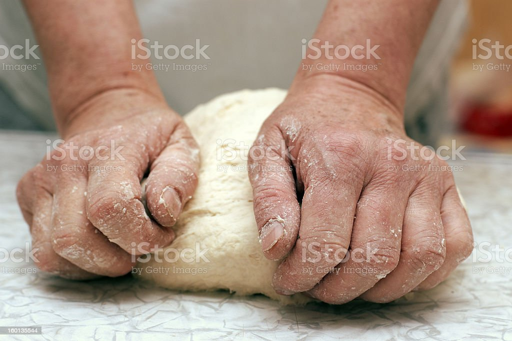 Close-up of a woman baker's hands kneading dough  royalty-free stock photo