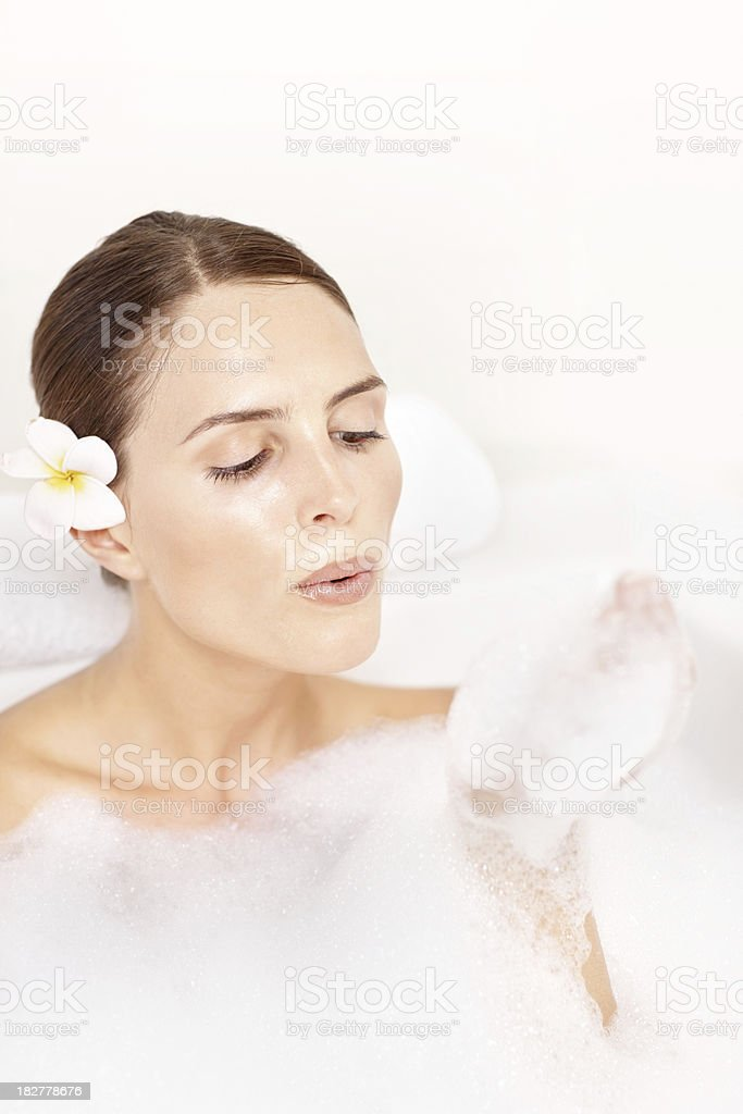 Close-up of a woman blowing bubbles in bath tub royalty-free stock photo