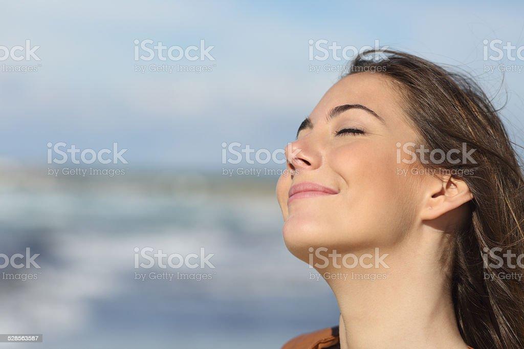 Closeup of a woman breathing fresh air on the beach stock photo