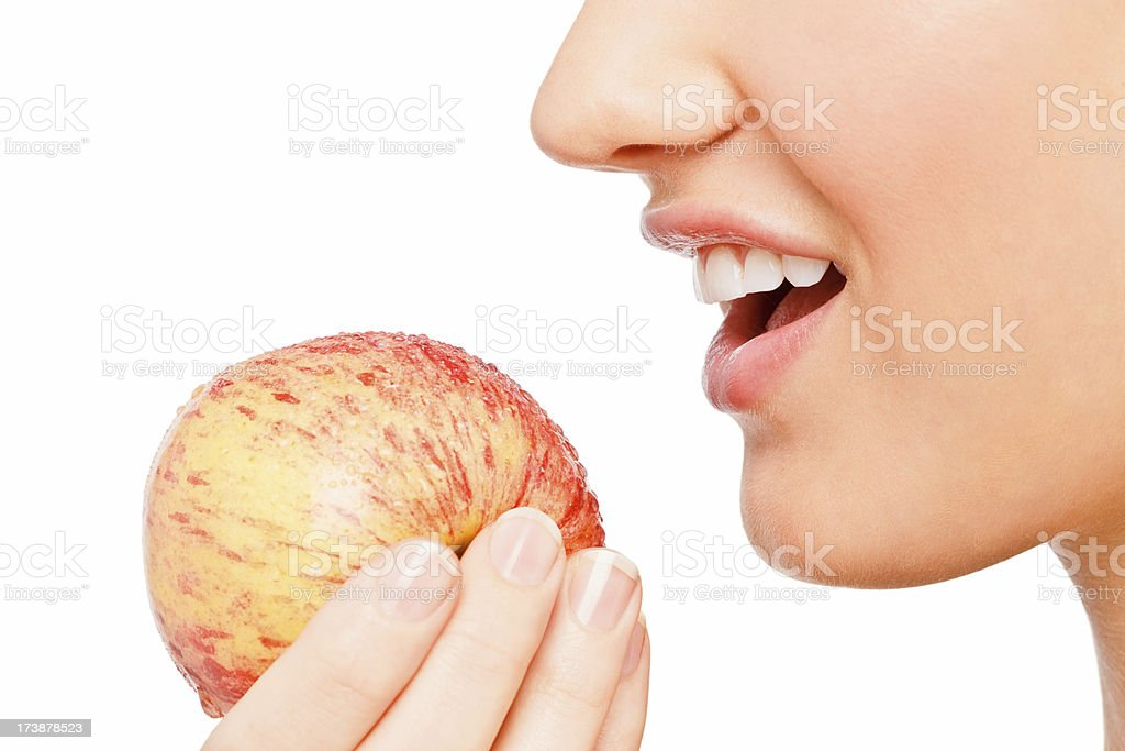 Closeup of a woman eating apply royalty-free stock photo
