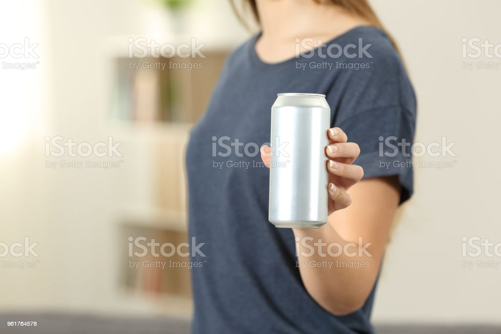 Closeup of a woman hand holding a soda drink can stock photo