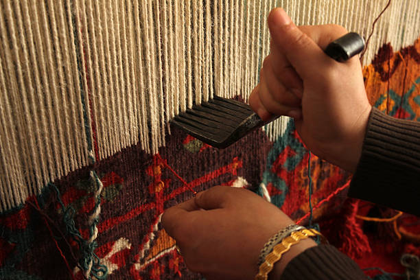 Close-up of a woman hand-weaving a colorful rug Rug anatolia stock pictures, royalty-free photos & images