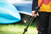 Close-up of a woman holding a paddle ready to explore the lake on kayak