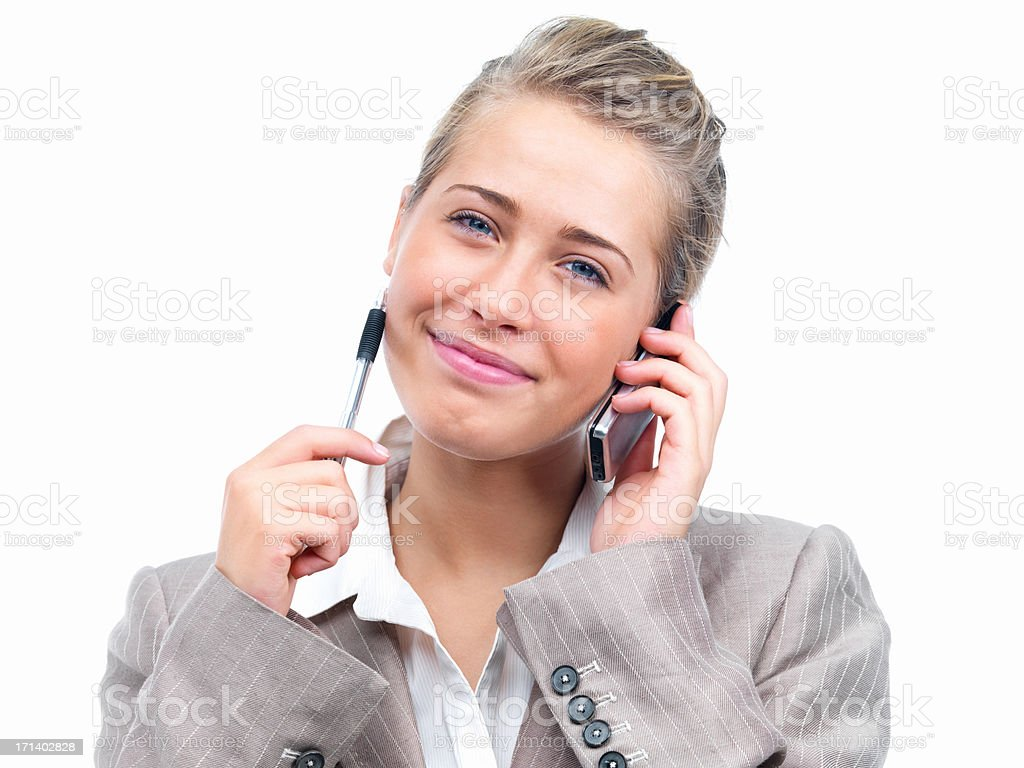 Closeup of a woman holding a pen and cellphone royalty-free stock photo