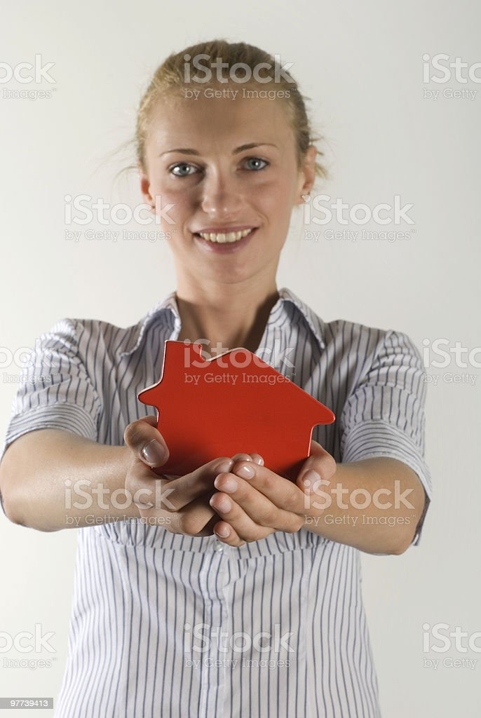 Close-up of a woman holding dollhouse royalty-free stock photo
