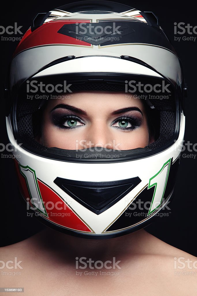 Close-up of a woman in a red and black biker helmet stock photo