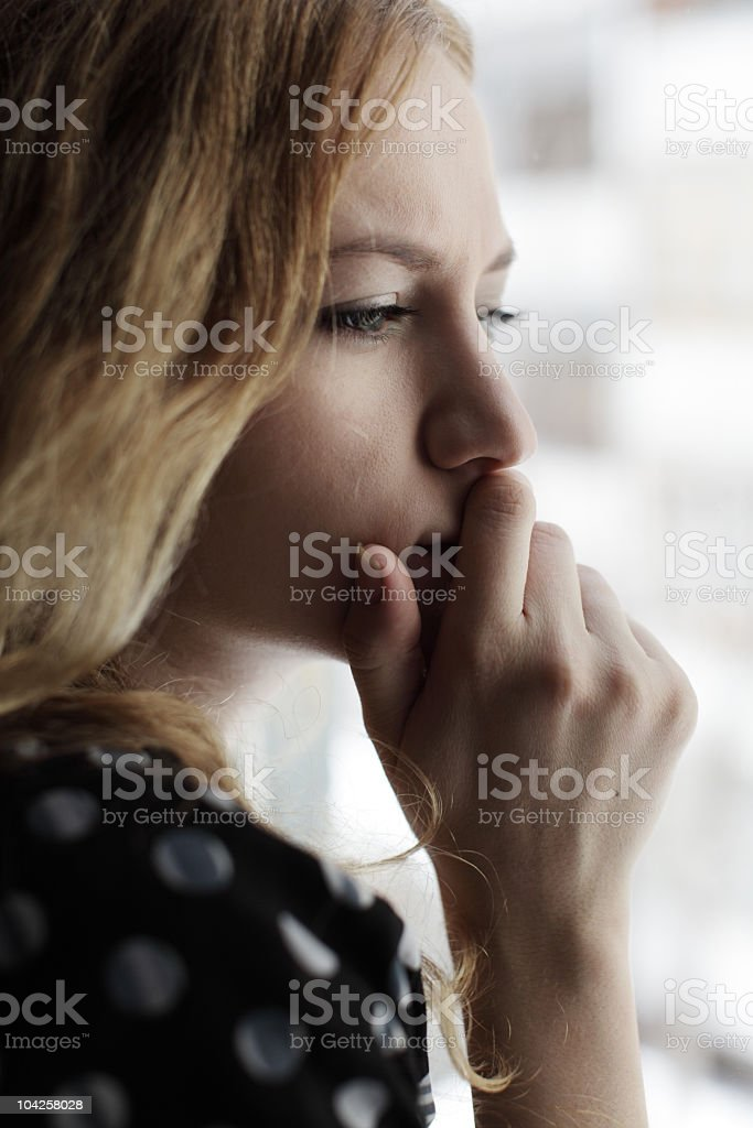 A closeup of a woman looking concerned and worried royalty-free stock photo