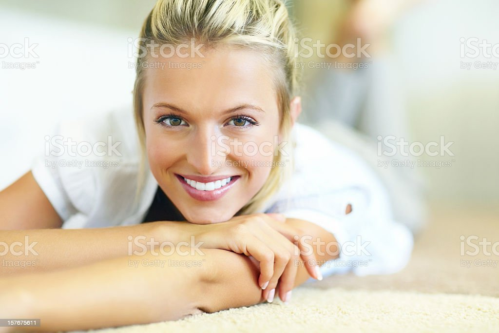 Closeup of a woman lying on bed with blurred background royalty-free stock photo