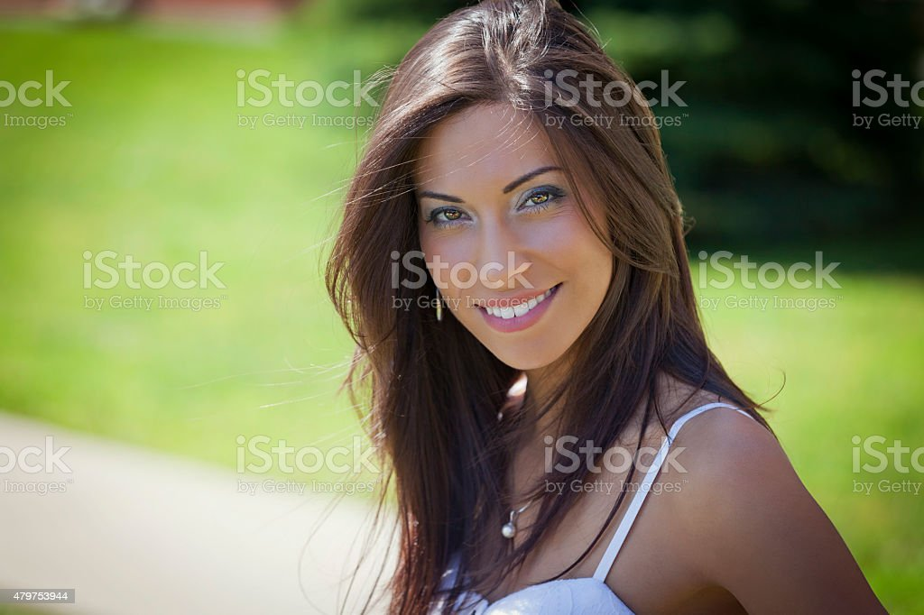 Closeup Of A Woman Smiling At The Park stock photo