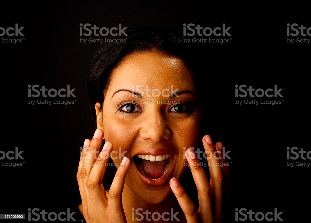 A close-up of a woman with her hands over her face royalty-free stock photo