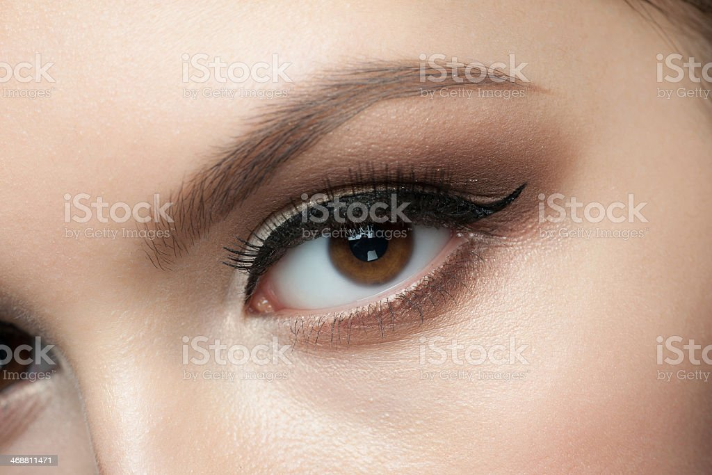 Close-up of a woman's face with elegant eye makeup stock photo