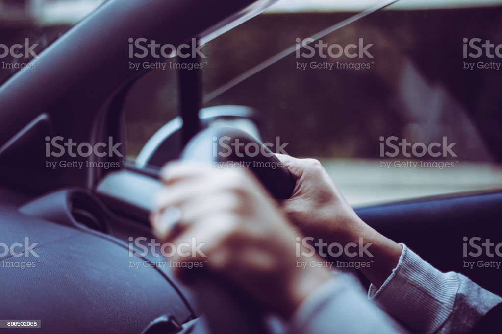 Close-up of a woman's hand holding a car handle stock photo