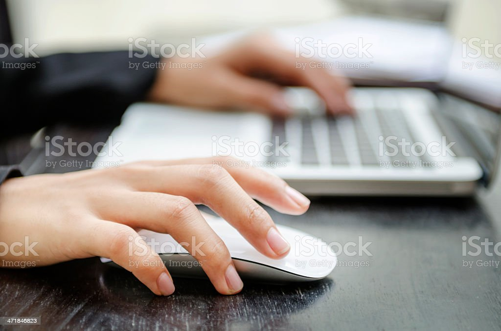 Close-up of a woman's hands on a mouse and keyboard stock photo