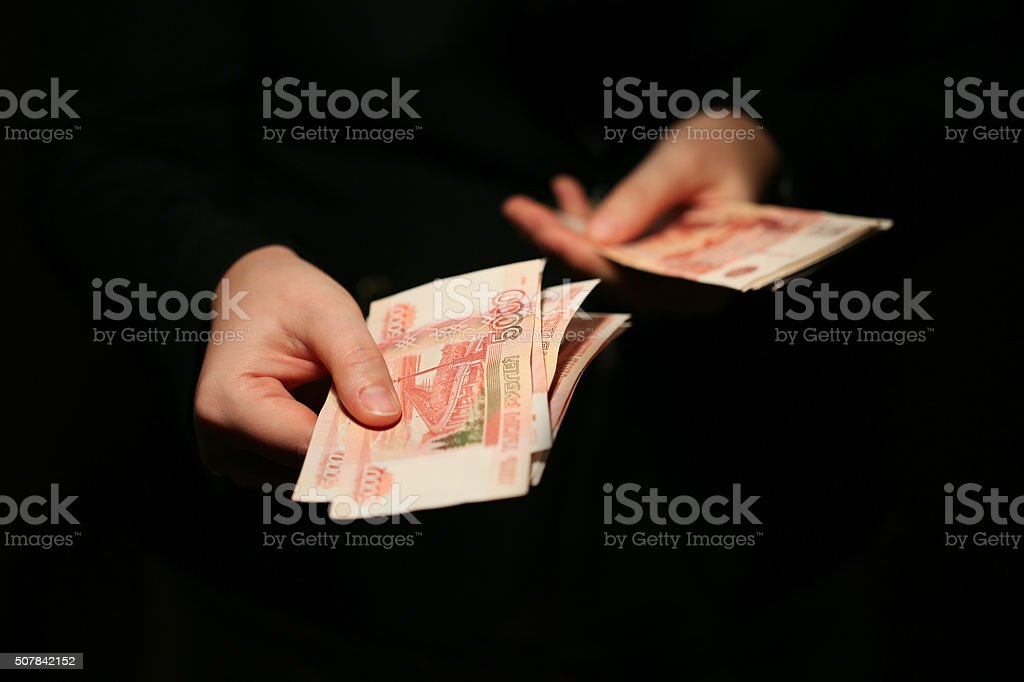 Close-up of a women hands counting Russian banknotes stock photo