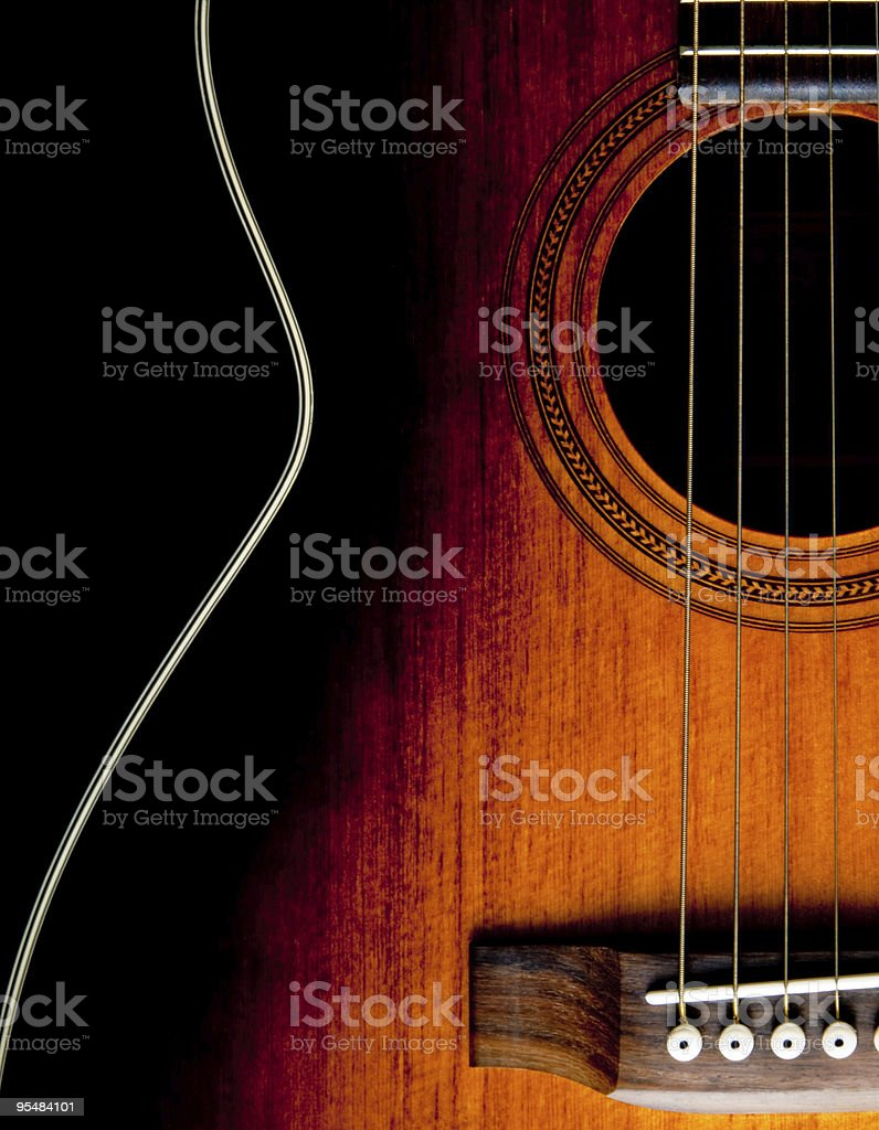 Close-up of a wooden guitar in a shadow stock photo
