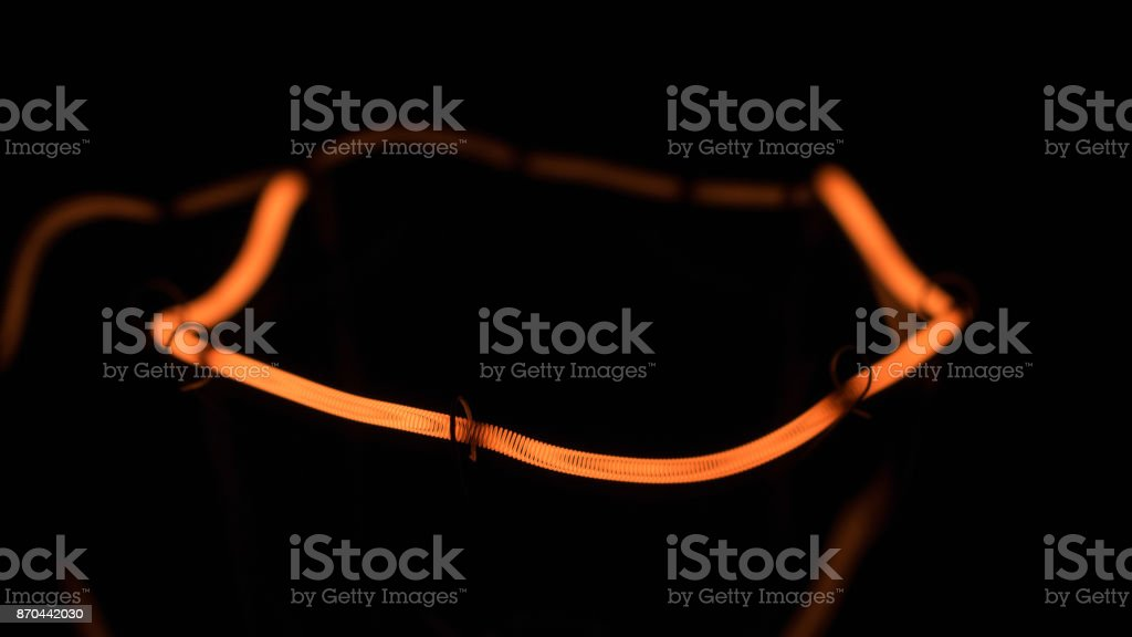 Close-up of a yellow spiral of a filament lamp. stock photo